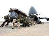 Loading Army CH-47 Chinook Helicopters onto an Air Force C-5 Galaxy Aircraft Wallpaper
